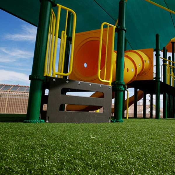 Artificial playground grass with yellow play equipment in New Jersey