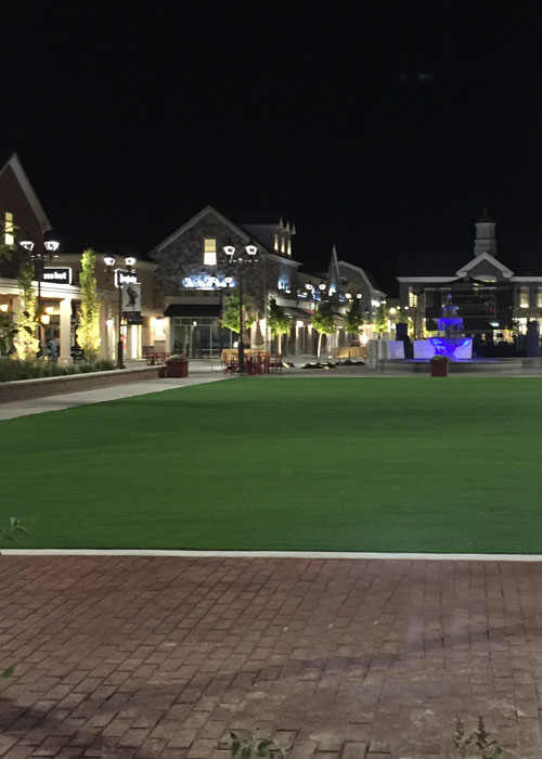 Public square with a synthetic lawn courtyard in Philadelphia