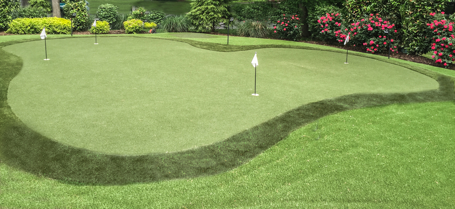 Practice turf putting green in Wilmington, PA with colorful flowers