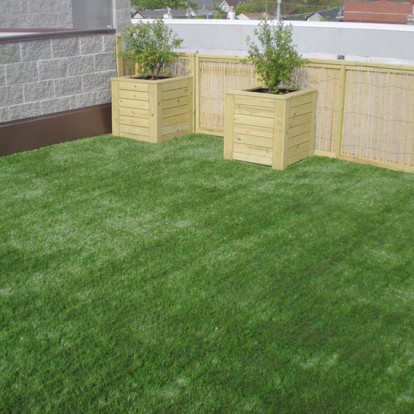 Boxed plants on an artificial grass roof deck in Philadelphia